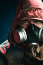 A man in a gas mask on a black background Royalty Free Stock Photo