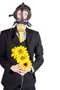 Man in gas mask with flowers a a holding a bouquet of yellow Stock Photos