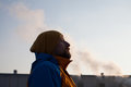Man gasping for air in polluted city