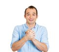 Man gesturing with clasped Stock Photography