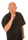 Man gesturing for quiet Royalty Free Stock Images