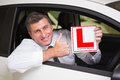 Man gesturing thumbs up holding a learner driver sign Royalty Free Stock Photo