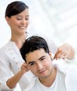 Man getting a haircut at the hair salon Stock Photos
