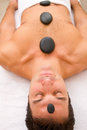 Man getting a massage with hot stones Royalty Free Stock Photo