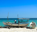 Man getting ready his boat order to go fishing yucatan peninsula beach Stock Photography