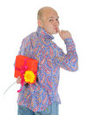 Man with a gift box and a flower Royalty Free Stock Images