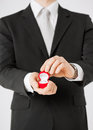 Man with gift box and wedding ring Royalty Free Stock Photo