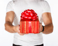 Man with a gift on white Royalty Free Stock Photography