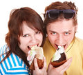 Man and girl eating cake. Royalty Free Stock Photo