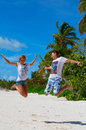 Man and girl jumping on the beach caribean island Stock Photo
