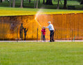 Man and girl washing wall at Vietnam memorial Royalty Free Stock Photo
