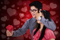 Man give a gift to his girlfriend portrait of young chinese men giving while covering her eyes shot with love background Royalty Free Stock Image