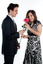 Man gives a woman flowers Stock Images
