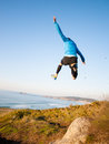 Man giving a big jump while practicing trail running Royalty Free Stock Photo