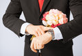 Man giving bouquet of flowers close up young Royalty Free Stock Photography