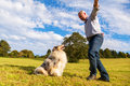 Man giving command to his dog Royalty Free Stock Photo