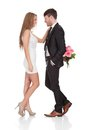 Man giving fresh flowers to woman isolated on white Stock Photos