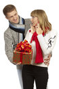 Man giving a gift to woman young men beautiful young Royalty Free Stock Photo