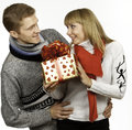 Man giving a gift to woman young men beautiful young Stock Photo