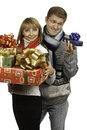 Man giving a gift to woman young men beautiful young Royalty Free Stock Images