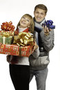Man giving a gift to woman young men beautiful young Stock Image