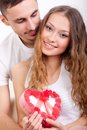 Man giving heart-shaped box  for his girlfriend Royalty Free Stock Images