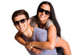 Man giving his pretty girlfriend a piggy back on white background Royalty Free Stock Images