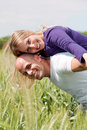 Man giving his wife a piggyback ride Royalty Free Stock Photography