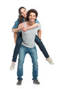 Man giving piggyback ride to her girlfriend portrait of young piggybacking isolated on white background Royalty Free Stock Photo
