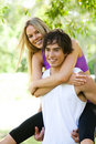 Man Giving Piggyback Ride to Woman in Park Royalty Free Stock Photos