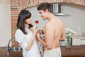 Man giving red rose to woman Royalty Free Stock Photo