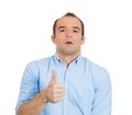 Man giving thumbs up closeup portrait of sarcastic young funny looking guy sign showing everything is alright when in reality is Royalty Free Stock Photos
