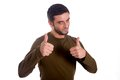 Man giving thumbs up the double hand gesture wearing a brown shirt on a white background Stock Image