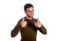 Man giving thumbs up smiling the double hand gesture wearing a brown shirt on a white background Royalty Free Stock Image