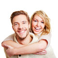 Man giving woman piggyback ride Stock Photos