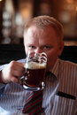 Man with glass of beer Royalty Free Stock Photos