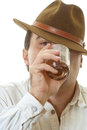 Man with glass of whisky young in hat holds cognac in hands Stock Images