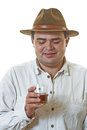 Man with glass of whisky young in hat holds cognac in hands Stock Photos