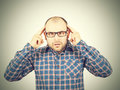 Man with glasses holding his head with his hands. Royalty Free Stock Photo