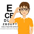 Man with glasses reading sight test characters Royalty Free Stock Photo