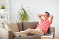 Man in glasses relaxing on sofa at home Royalty Free Stock Photo