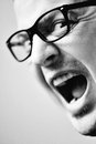 Man with glasses yelling at someone Royalty Free Stock Photo
