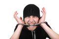 Man gnaw his handcuffs angry isolated on the white background Stock Photography