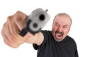 Man goes wild with his gun screams out loud middle age wile holding at left hand pointed at you Royalty Free Stock Image