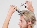 Man going to shave his long hair Royalty Free Stock Photo