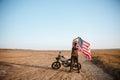 Man in golden helmet holding american flag at the desert Royalty Free Stock Photo