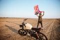 Man in golden helmet waving american flag at the desert Royalty Free Stock Photo