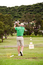 Man on golf driving range senior practising Royalty Free Stock Photography