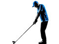 Man golfer golfing golf swing silhouette one in studio isolated on white background Stock Images