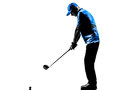 Man golfer golfing golf swing silhouette one in studio isolated on white background Royalty Free Stock Photo